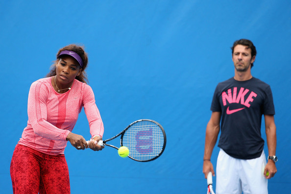 Serena Williams of the United States of America is watched by her coach Patrick Mouratoglou in a practice session during day nine of the 2013 Australian Open ' January 22, 2013 in Melbourne, Australia.