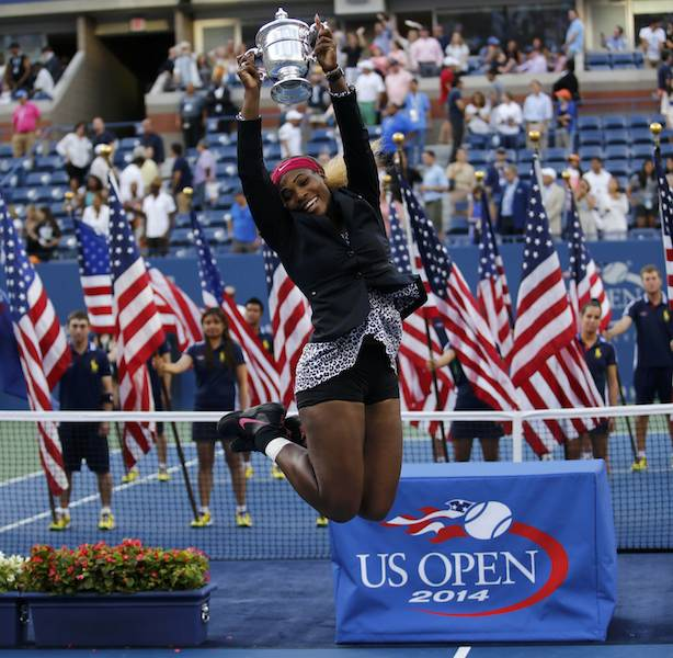 American Serena Williams jumps with with joy after defeating Caroline Wozniacki of Denmark in their women's singles finals match at the 2014 US Open tennis tournament in New York, September 7, 2014. – Reuters pic, September 8, 2014.