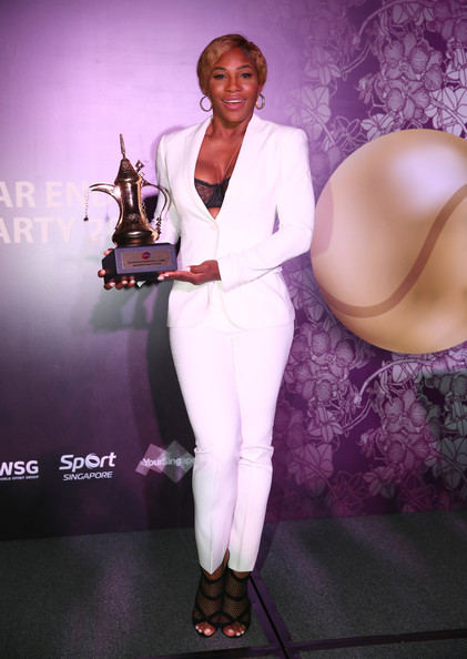 American Serena Williams  poses with her WTA Year End World Number One Singles Trophy at the 2014 WTA Year End Gala Party at the Marina Bay Sands Hotel during the BNP Paribas WTA Finals at Singapore Sports Hub on October 25, 2014 in Singapore. (October 24, 2014 - Source: Clive Brunskill/Getty Images AsiaPac)
