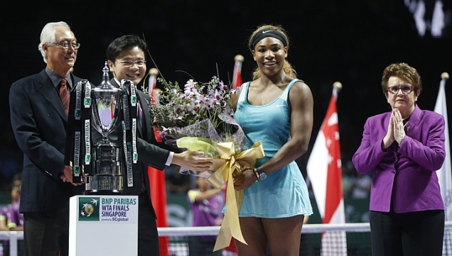 Singapore really  captured her heart, naming an orchid after her.  Lawrence Wong, Minister for Culture, Community & Youth & Second Minister for Ministry of Communications & Information, presenting a bouquet of  the flowers - to winner Serena Williams. Emeritus Senior Minister Gok Chok Tong & tennis legend Billie Jean King look on during the BNP Paribas WTA Finals Singapore trophy presentation at the Singapore Indoor Stadium on Oct 26, 2014.   (PHOTO: KEVIN LIM)