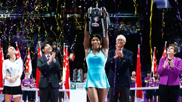 Serena Williams holds the victors trophy aloft, after winning the 2014 WTA Championship Final in Singapore. (AP Photo)