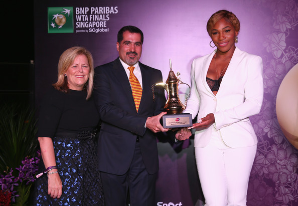 Serena Williams with Stacey Allaster WTA CEO and Chairman, Salah Tahlak from Dubai Duty Free at the WTA Year End Gala Party at the Marina Bay Sands Hotel during the BNP Paribas WTA Finals at Singapore Sports Hub on October 25, 2014 in Singapore. (October 24, 2014 - Source: Clive Brunskill/Getty Images AsiaPac)