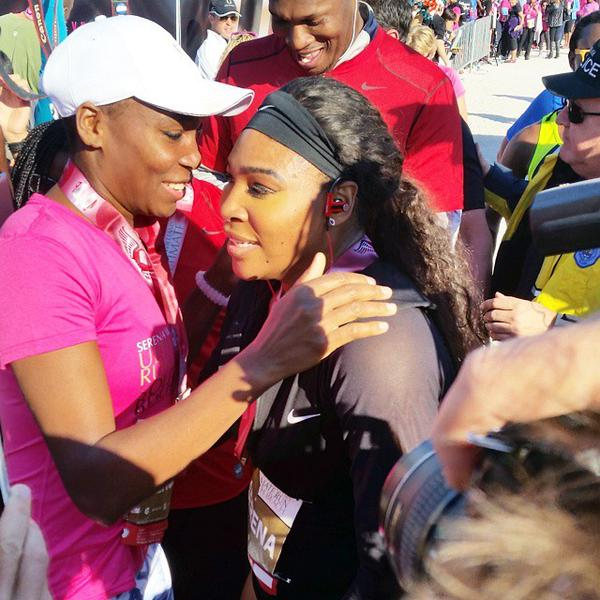 The two sisters embrace at the conclusion of their leg of the Serena Williams Ultimate Run for charity.