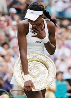 Venus Williams after winning the Wimbledon title in 2007. (Credit: AP)