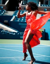 VENUS IN RED DRESS AND HEELS ON COURT