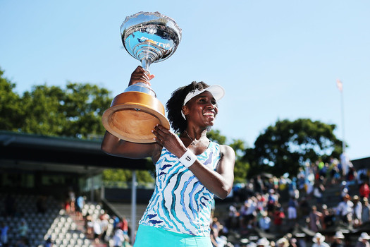 Venus Williams hoists the trophy after her ASB Classic win over Denmark's Caroline Wozniacki Photo by Anthony Au-Yeung/Getty Images