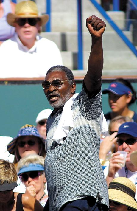 Richard Williams, father of Venus and Serena, gives the 'Black Power' salute to raucous Indian Wells fans in 2001.