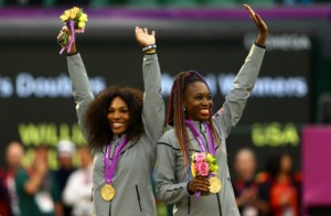 Gold medalists Serena Williams of the United States and Venus Williams of the United States celebrate on the popdium during the medal ceremony for the Women's Doubles Tennis on Day 9 of the London 2012 Olympic Game